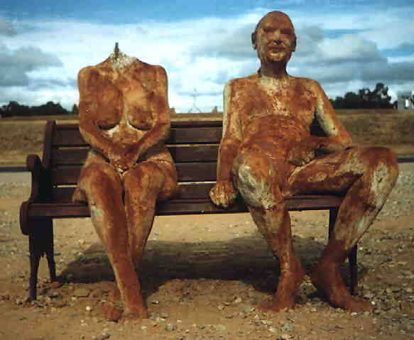 """Greg Taylor """"Down by the Lake with Liz and Phil"""" / saw, sledgehammers   (In 2010, a series of vandals attacked this controversial sculpture, which depicts Queen Elizabeth and Prince Philip sitting together naked on a park bench. The work, installed by a lake near Canberra Australia's High Court, had been on view for only a week before vandals repeatedly attacked the work, successfully beheading and severing legs from both sculptures and caving in Philip's chest. The sculpture was permanently removed as a result.)"""