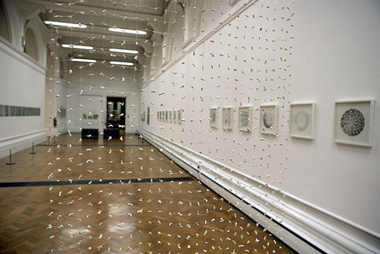 """Sue Lawty """"Mesh"""" / security guard   (In 2006, while on display at London's Victoria & Albert Museum, this textile art installation was destroyed when a security guard, walking through the darkened gallery during closed hours, tripped on a security barrier and fell into it, dragging the work down with him as he fell.)"""