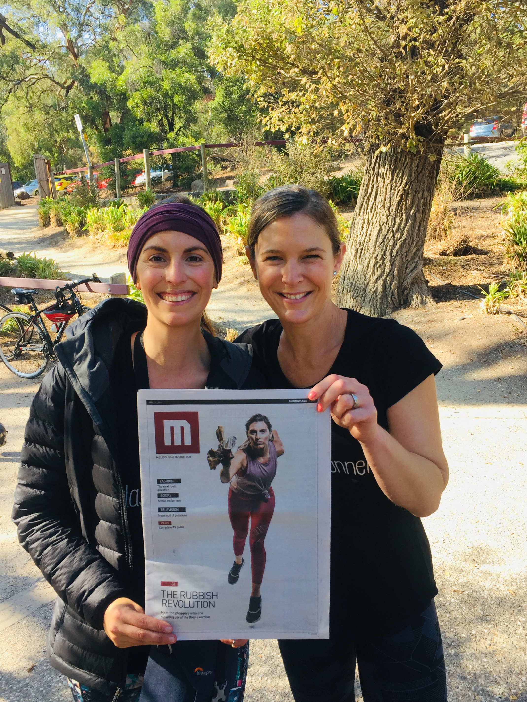 Co-Founders Karin and Debbie showing the cover of M Magazine