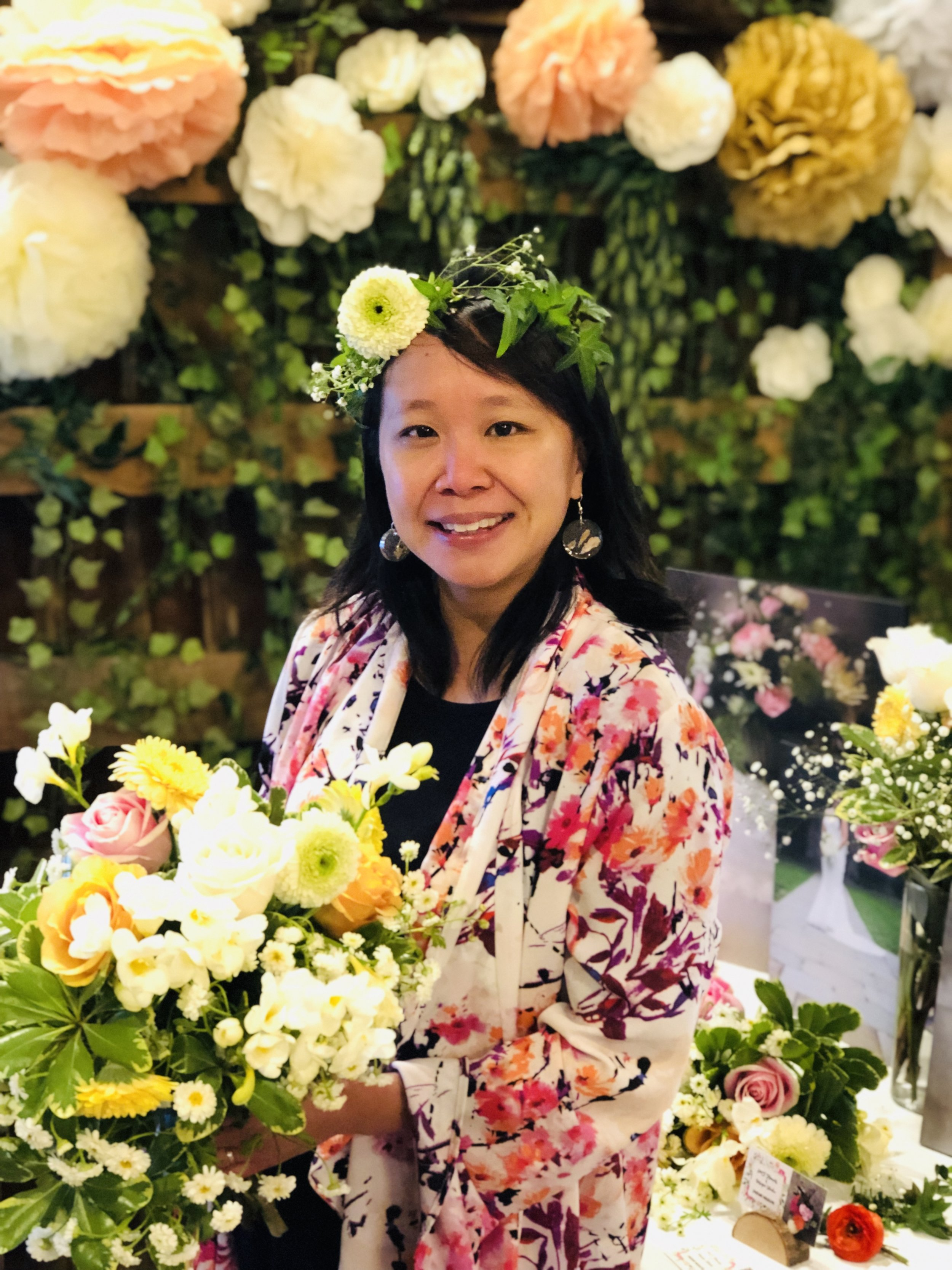 Elaine Lok, Owner & Designer, LMF Flowers & Design Studio - Elaine found her true passion through floral design after studying photography at the College for Creative Studies. Like, any artistic medium, Elaine finds creating arrangements with fresh flowers and verdant foliage, a wonderful way to engage all five of your senses!
