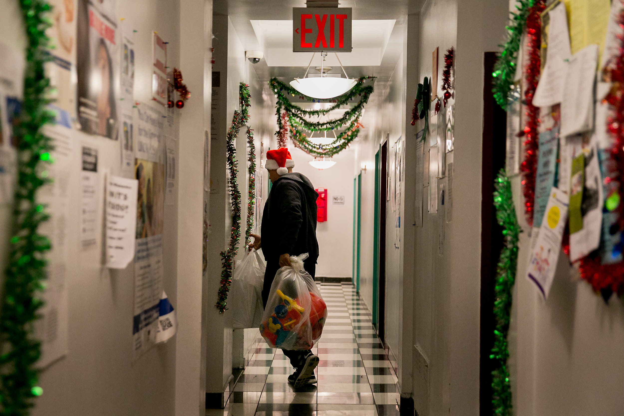 Mover Marc McCauley carries the belongings of Madelyn Brito out of the Kingston Family Residence homeless shelter in Brooklyn, New York.