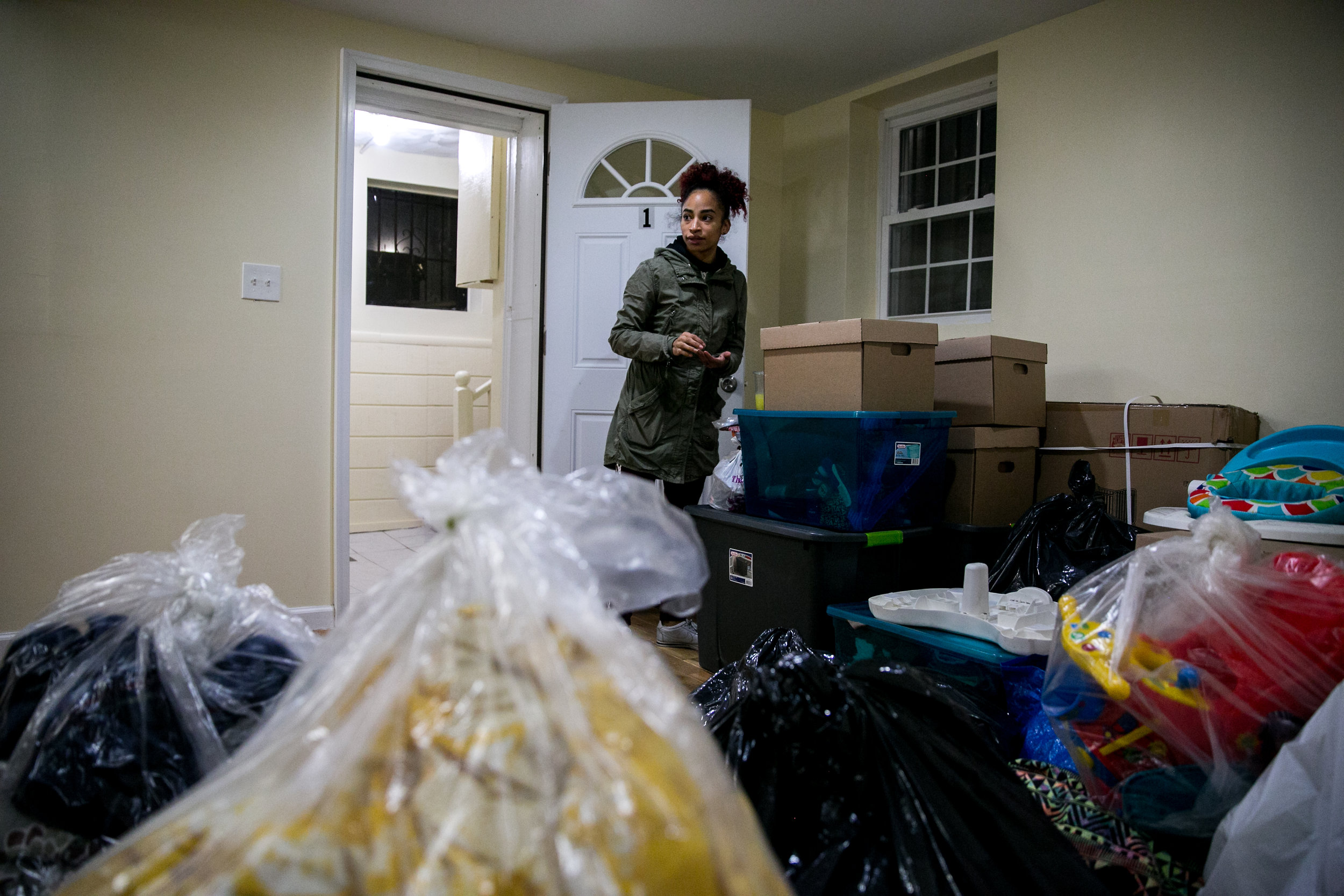 Madelyn Brito stands in her new apartment for the first time with all her belongings in East New York as she moves out of the Kingston Family Residence homeless shelter in Brooklyn, New York.