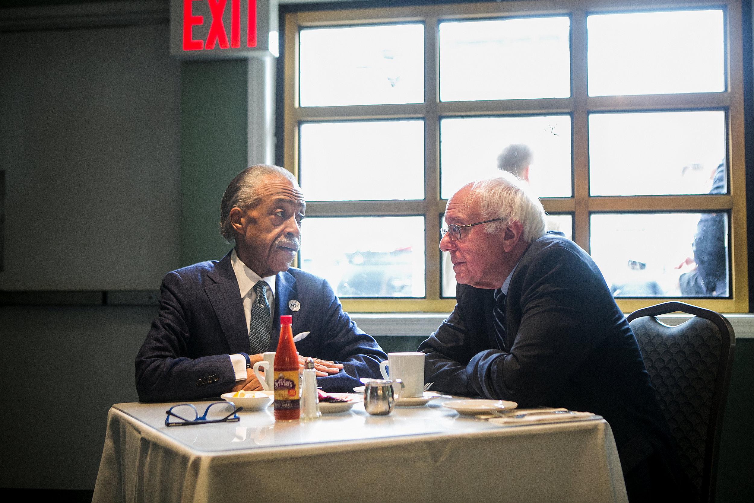 Reverend Al Sharpton meets with Senator Bernie Sanders, a Democratic presidential candidate, at Sylvia's Restaurant in Harlem