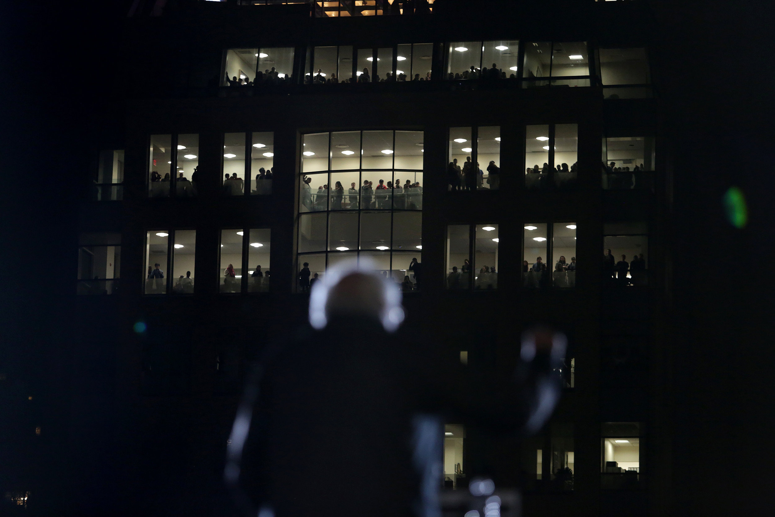 From behind the stage, you could see students in a building at NYU watching over the event.