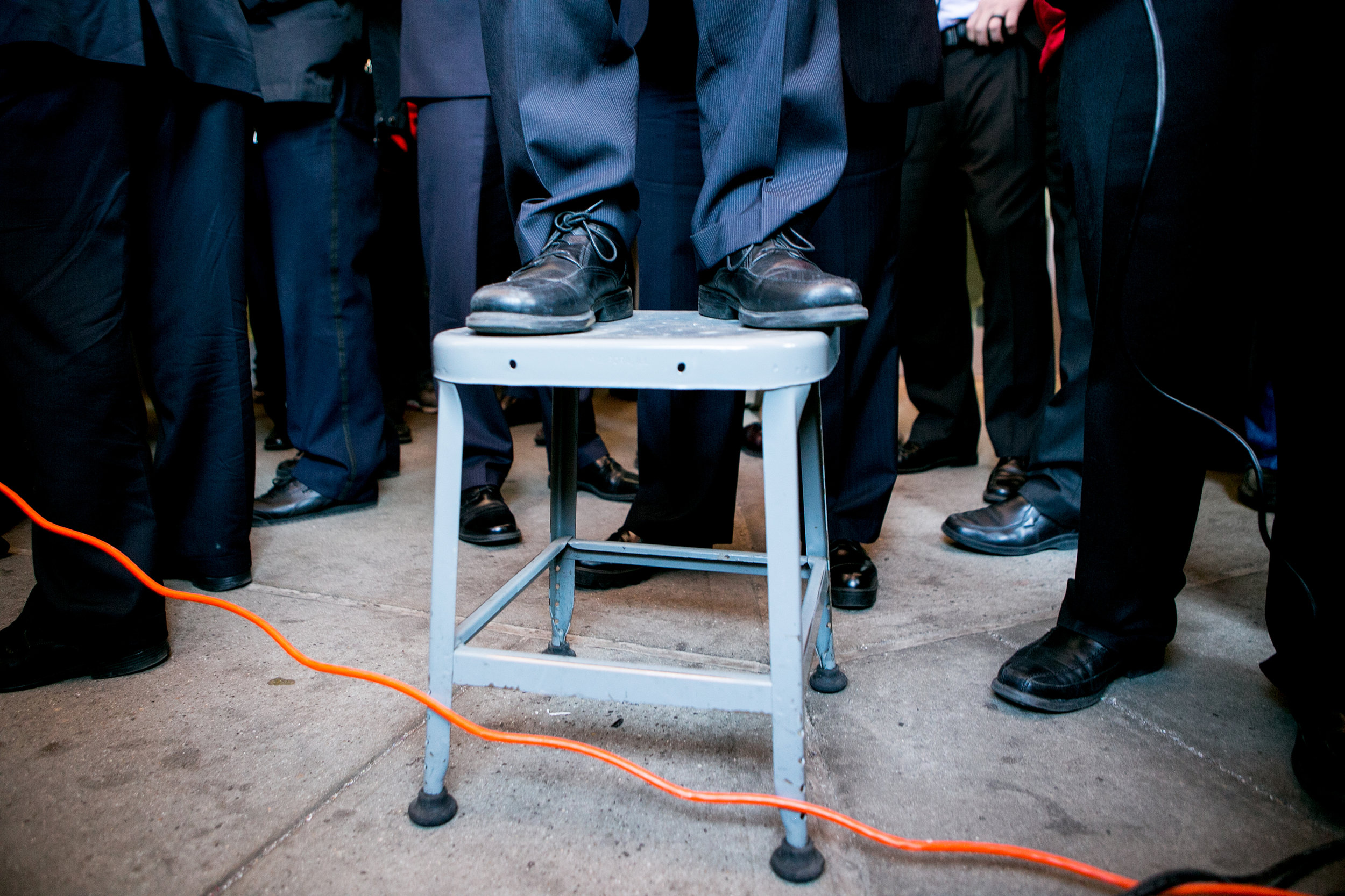 With his scuffed up shoes, surrounded by Secret Service agents,Bernie climbed a top a stool to address a picket line with workers from Communication Workers of America in Brooklyn.