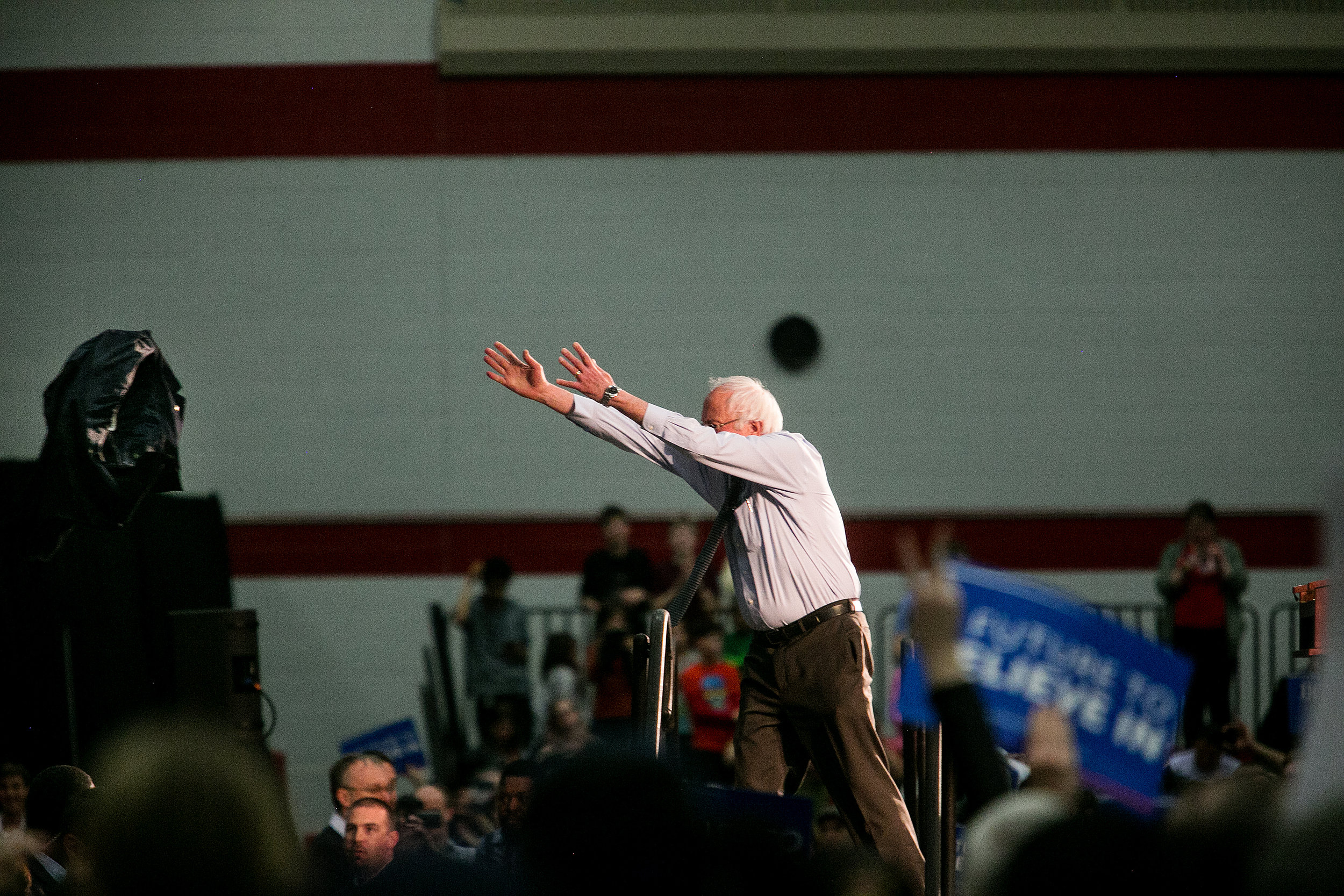 Bernie heaves his jacket off the stage at a rally in a sweltering gymnasium at Milton High School in Milton, Massachusetts.