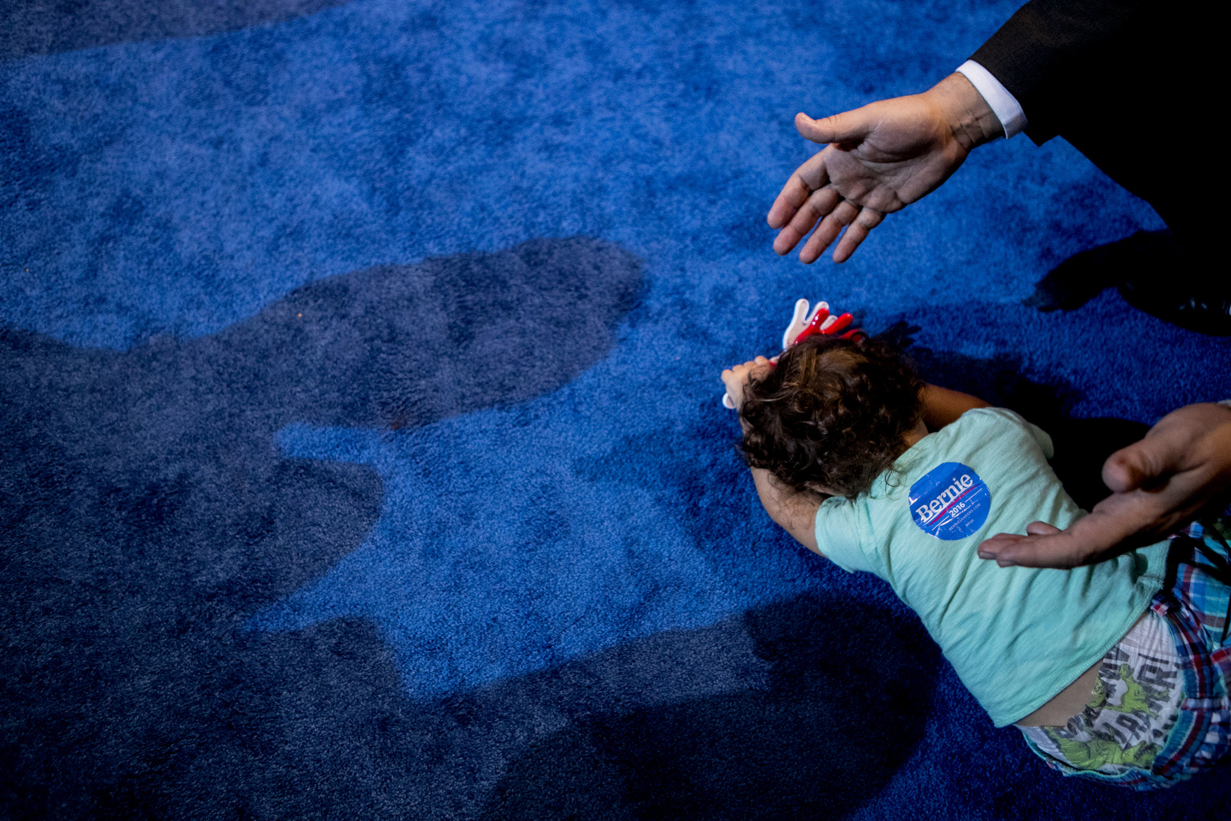 A young Bernie supporter refuses to get up off the convention floor.