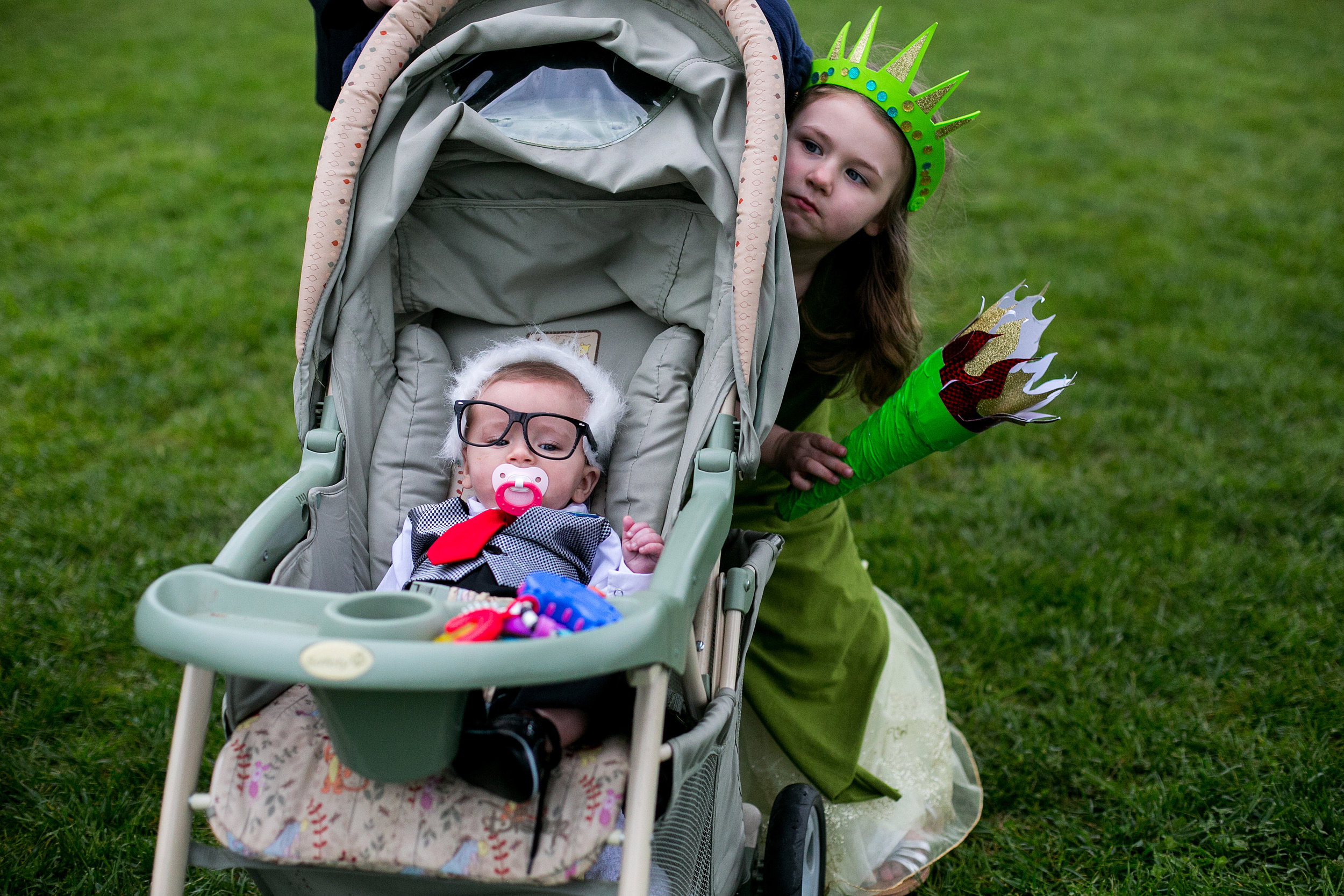 Lucian Toler, 5 months old and his sister Kathryn Toler, 4 years old, wait to hear Democratic presidential candidate Bernie Sanders speak at a rally in Louisville, Kentucky