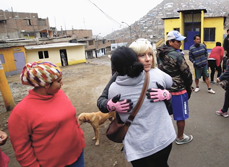 Linda greets a few of the women from Santa Rosita as they prepare for a day of ministry.