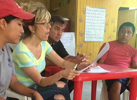 Linda and Greg review documents as they prepare construction for another pre-fabricated home in Santa Rosita.