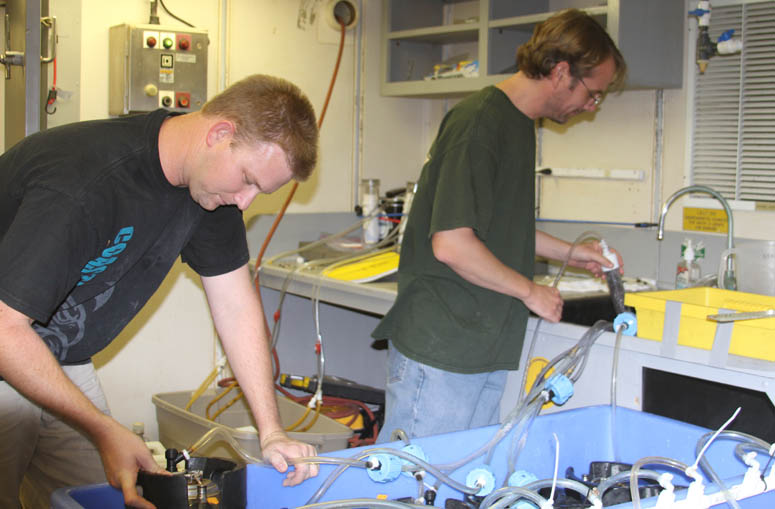 Rick Peterson and Rich Viso (CCU) preparing samples for radium analysis