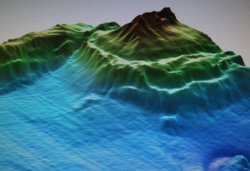 Multibeam seismic image of a mud volcano; the hotter colors are more shallow, showing how the mud volcano rises from the seafloor