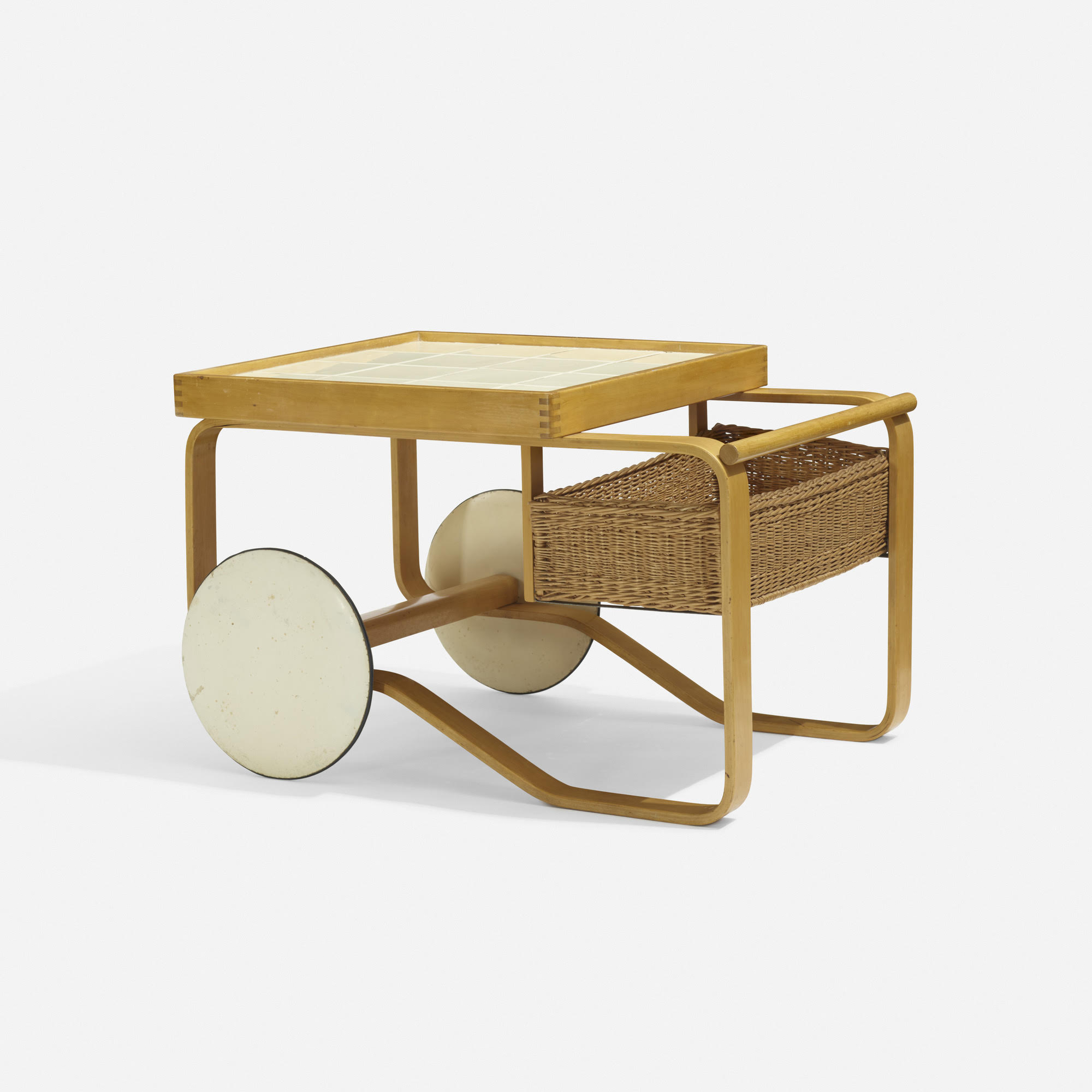 Alvar Aalto Tea Trolley   Price Upon Request. Email mylaoutpost@gmail.com  Artek Finland, 1937 birch, tile, rattan, lacqueredwood, rubber 35½ w × 25½ d × 23 h in 90 × 65 × 58 cm