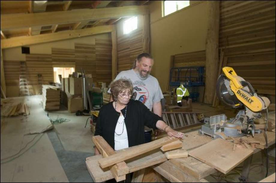 cecile and james in longhouse in progress from seattle pi.jpg