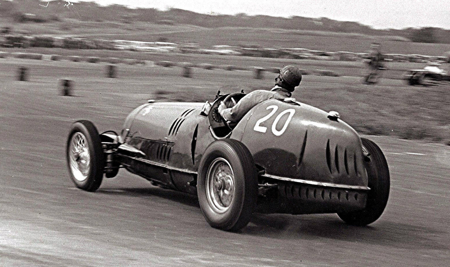 Dennis Poore races an Alfa Romeo in his racing days - 1952