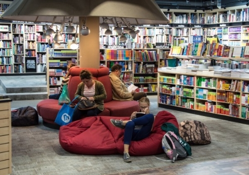 people-sitting-on-sofas-and-reading-books-in-bookstore.jpg