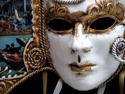 """""""Siege of the Heart"""" was written by Elise Cyr, the pen name of the author behind this mask."""