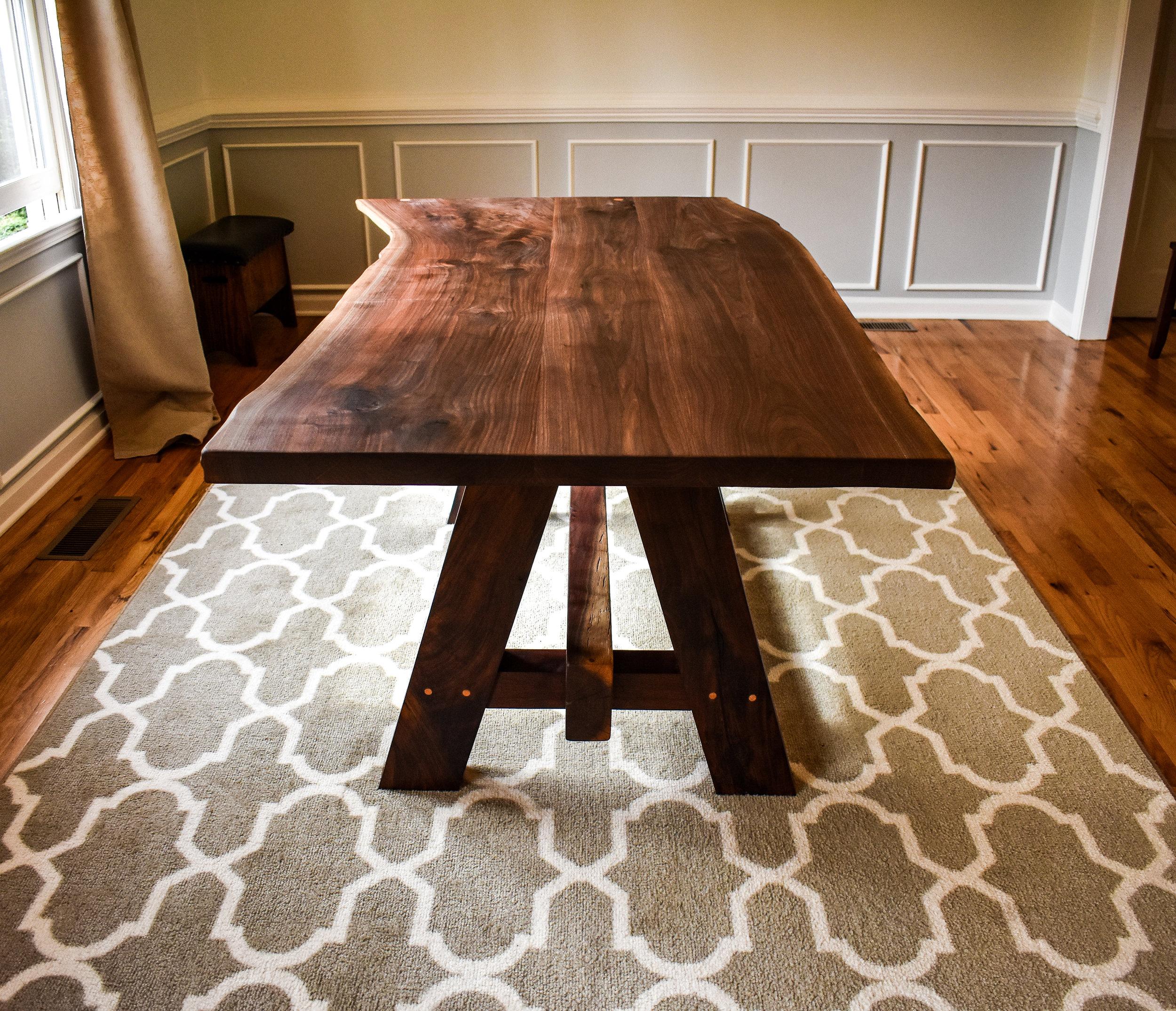 """Black walnut live-edge table: 6' long x 42"""" - 37"""" wide x 31.5"""" tall."""