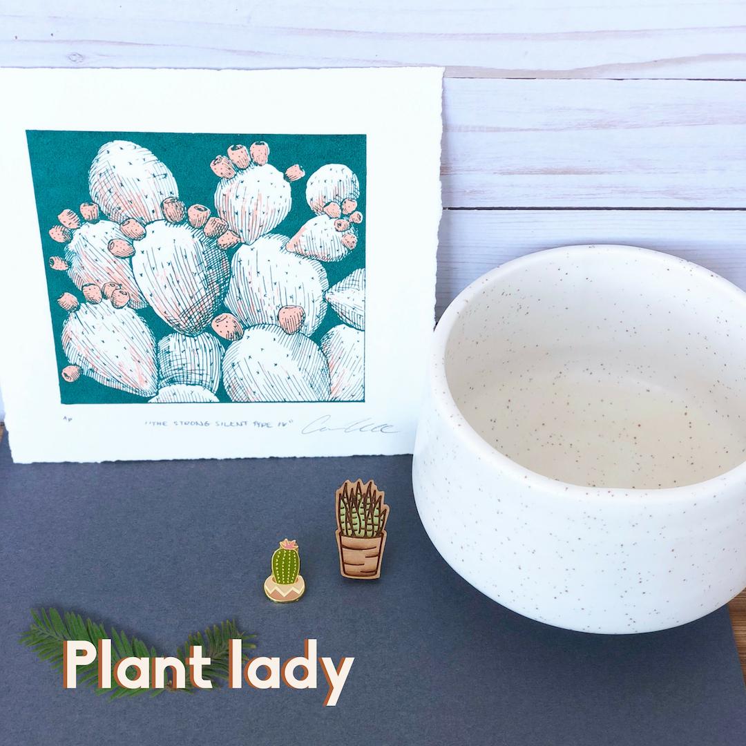 Plant Lady, cactus print, white planter, aloe vera pin, and cactus pin.