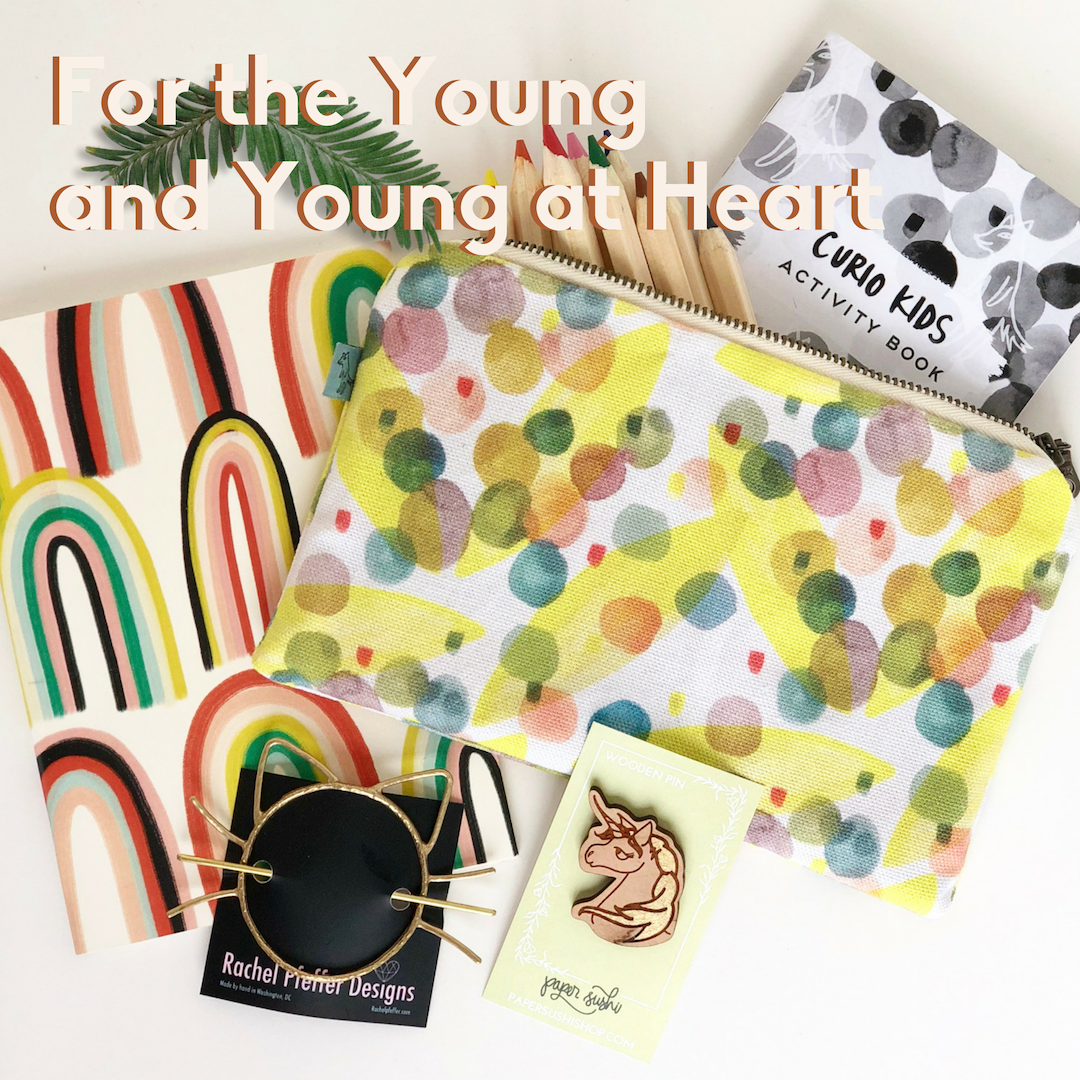 Young and young at heart: Yellow pouch, rainbow journal, cat hairpin, unicorn pin.