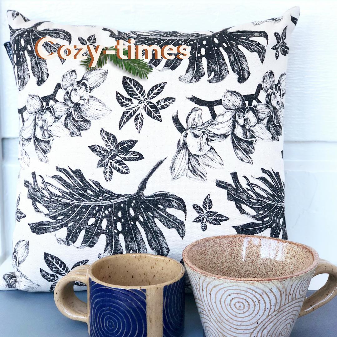 Cozy Times: Tropical pillow, blue coffee mug, white soup mug.