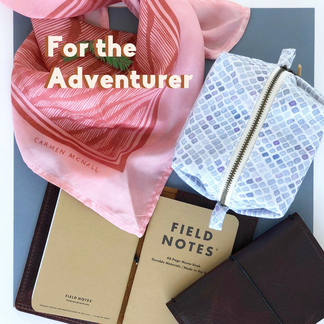 Adventurer: Pink silk scarf, blue mesh pouch, brown leather notebook.
