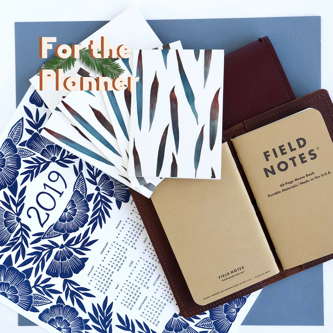 Planner: Blue 2019 calendar, brush strokes notecards, brown leather notebook.