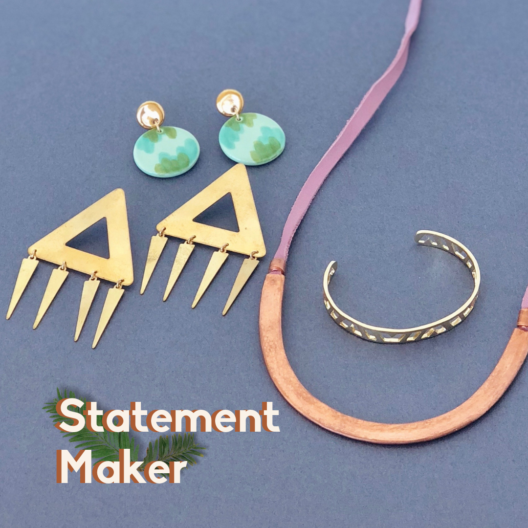 Statement Maker: green abstract earrings, triangle earrings, copper and leather necklace, silver bracelet.