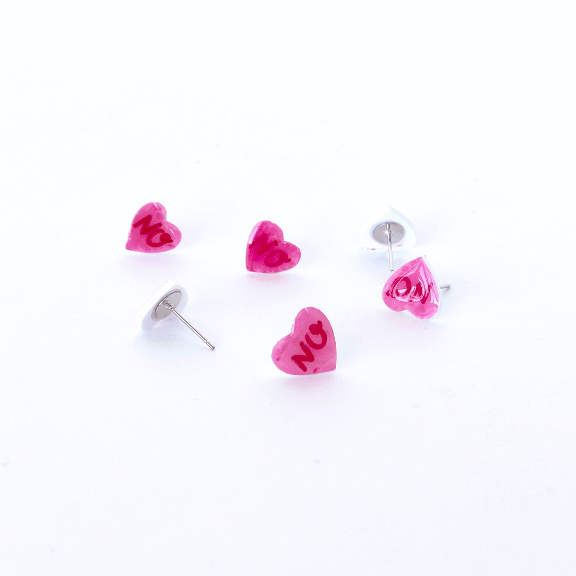 Conversation heart stud earrings.