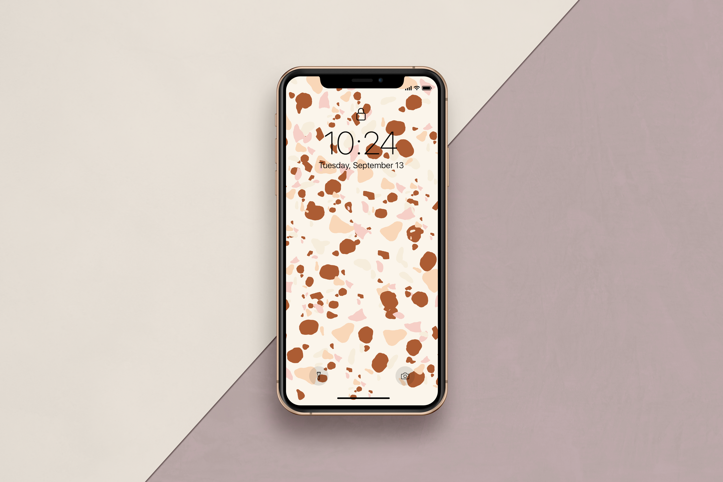 Phone with terrazzo wallpaper.