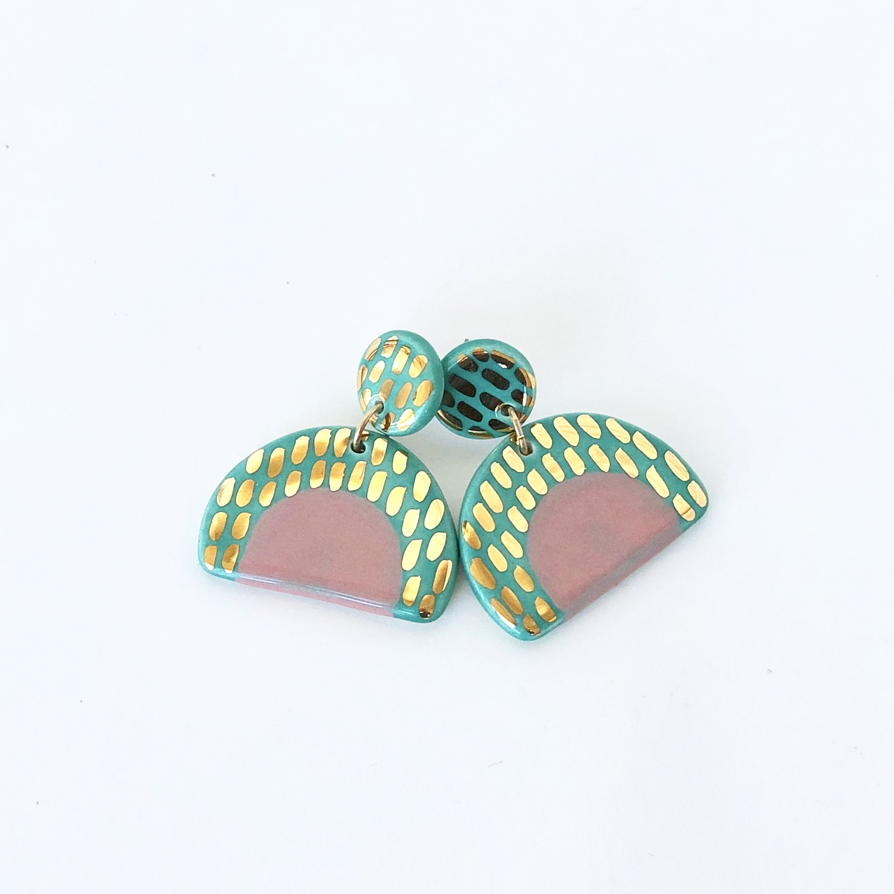 Green, pink, and gold statement earrings.