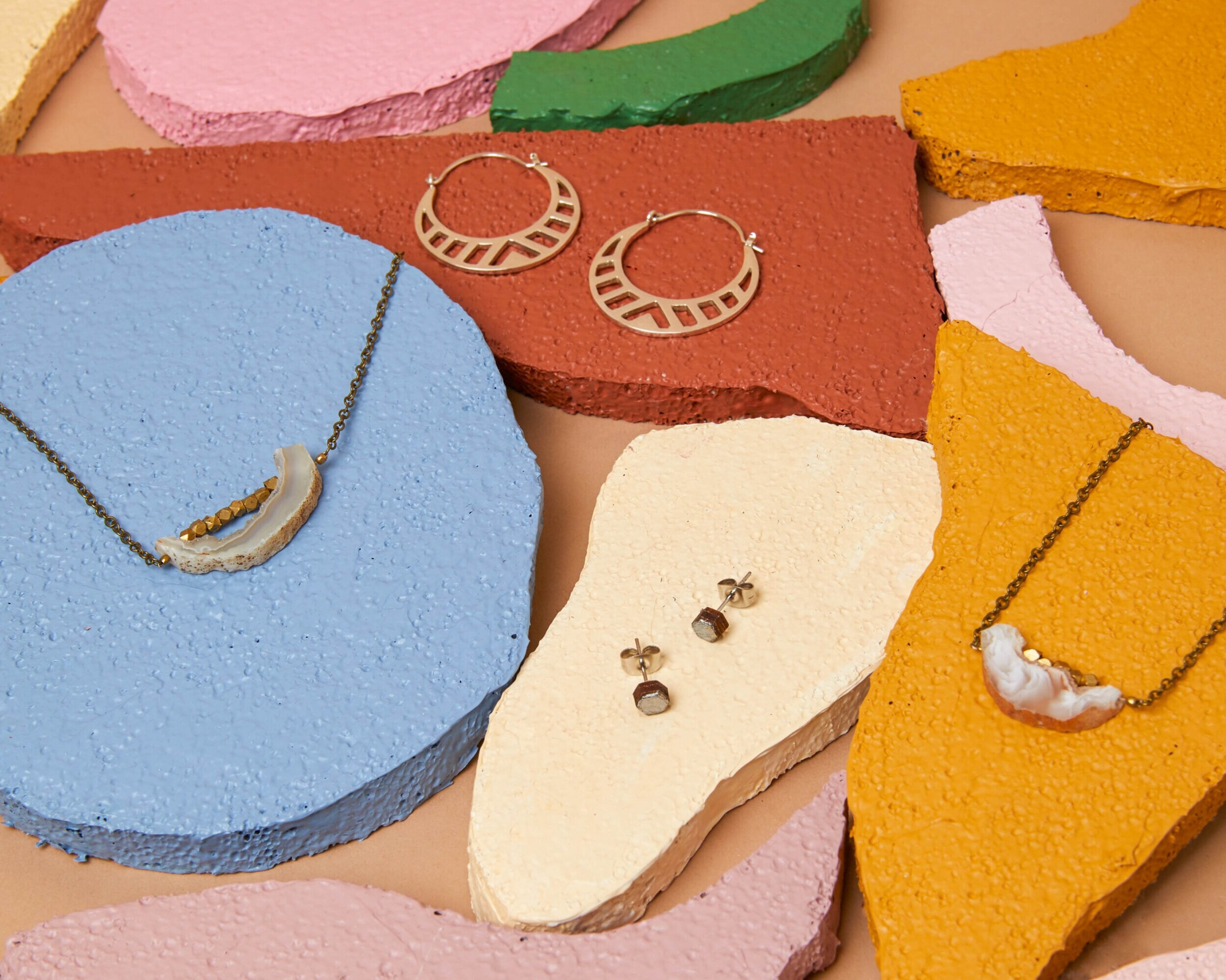 A selection of jewelry from Handheld Handmade.
