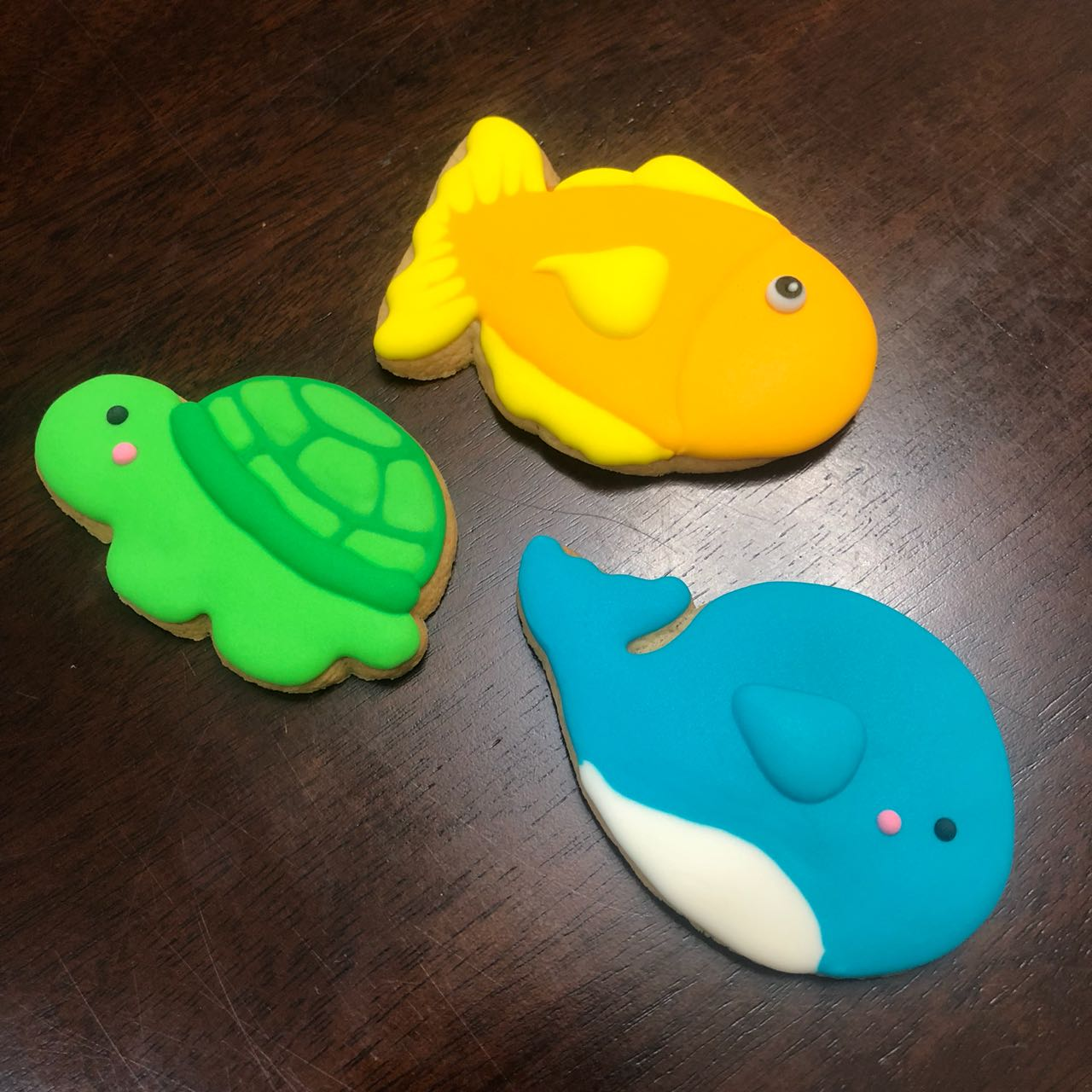 Decorated Cookies. Whale, turtle, fish. Blue, white, orange, yellow, green, pink black colors. Royal Icing Cookies.