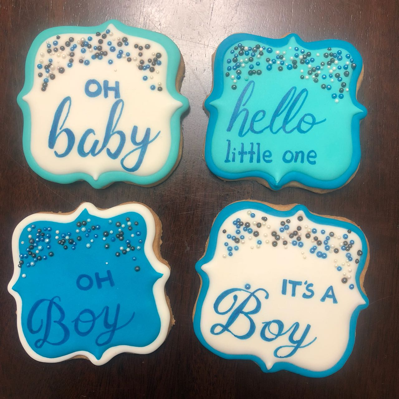 cookies, decorated cookies. it's a boy. baby shower. baby boy. baby. celebrate. royal icing. blue white. sprinkles