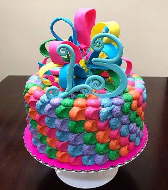 vanilla cake birthday cake pink orange green blue purple ribbon fondant buttercream happy birthday
