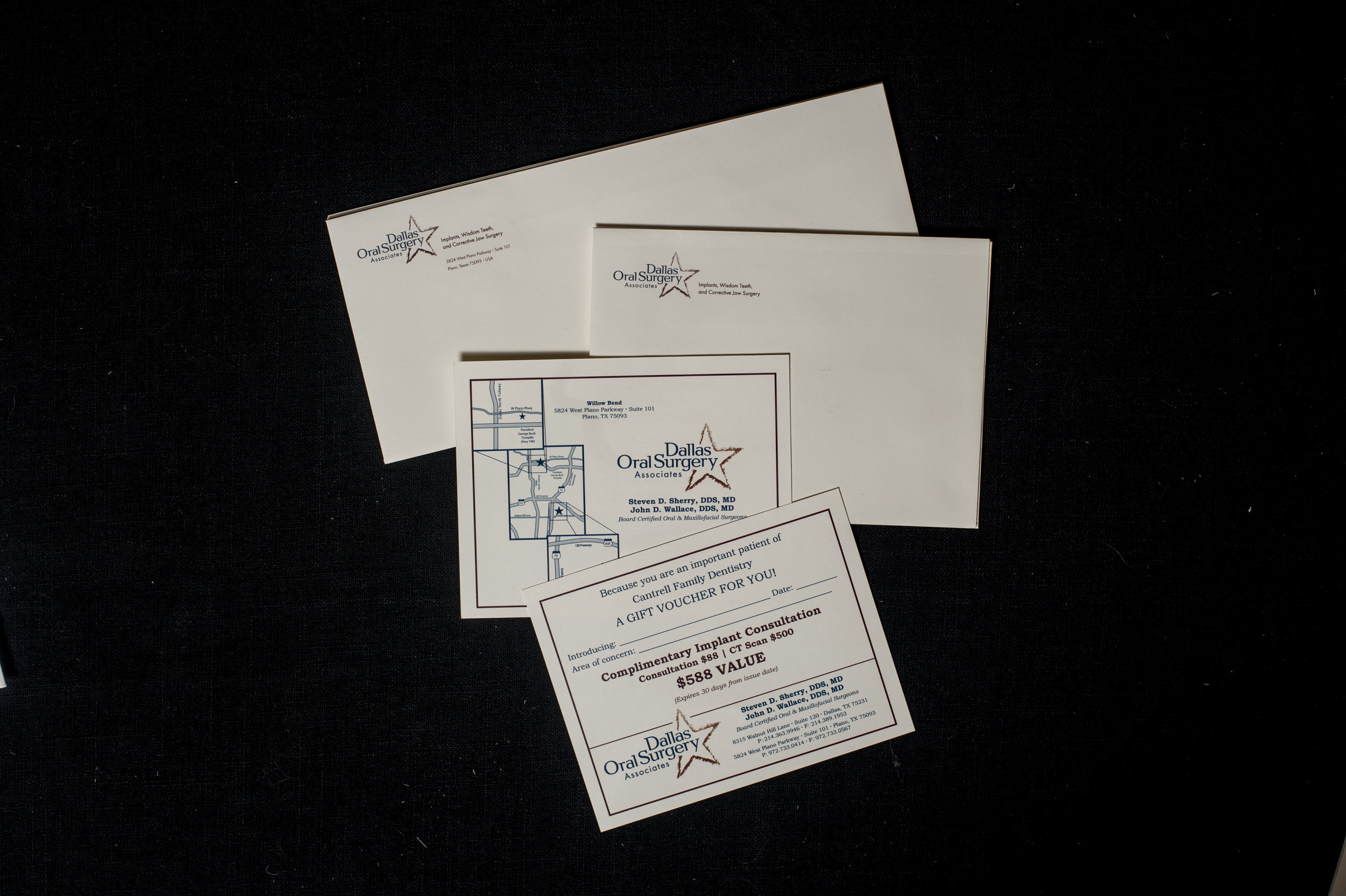 Custom envelopes and collateral pieces we printed for Dallas Oral Surgery Associates.