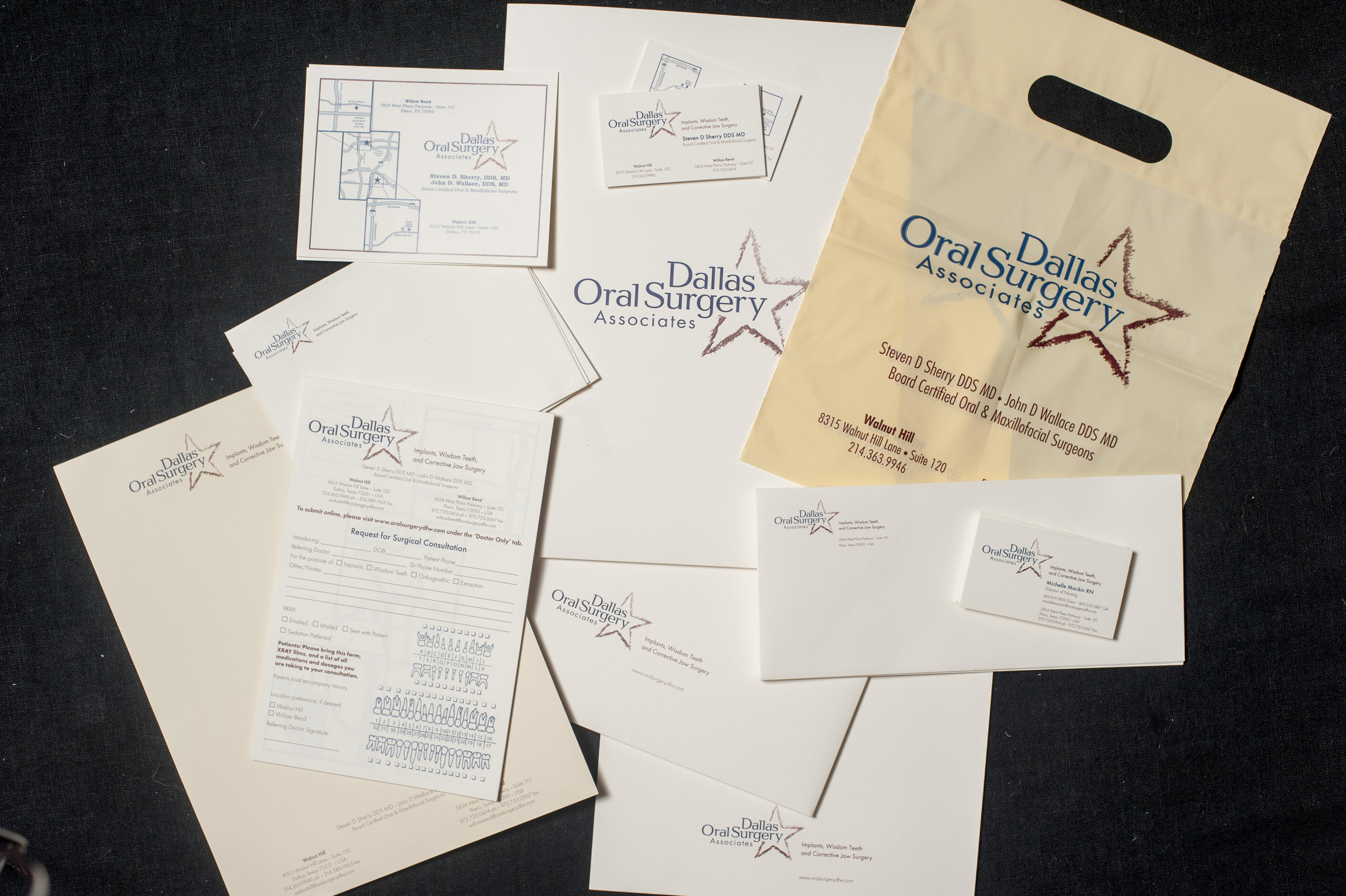 A full collection of custom printed business literature for Dallas Oral Surgery Associates, including embossed business cards, appointment cards, bags, notepads, folders, envelopes, and more.