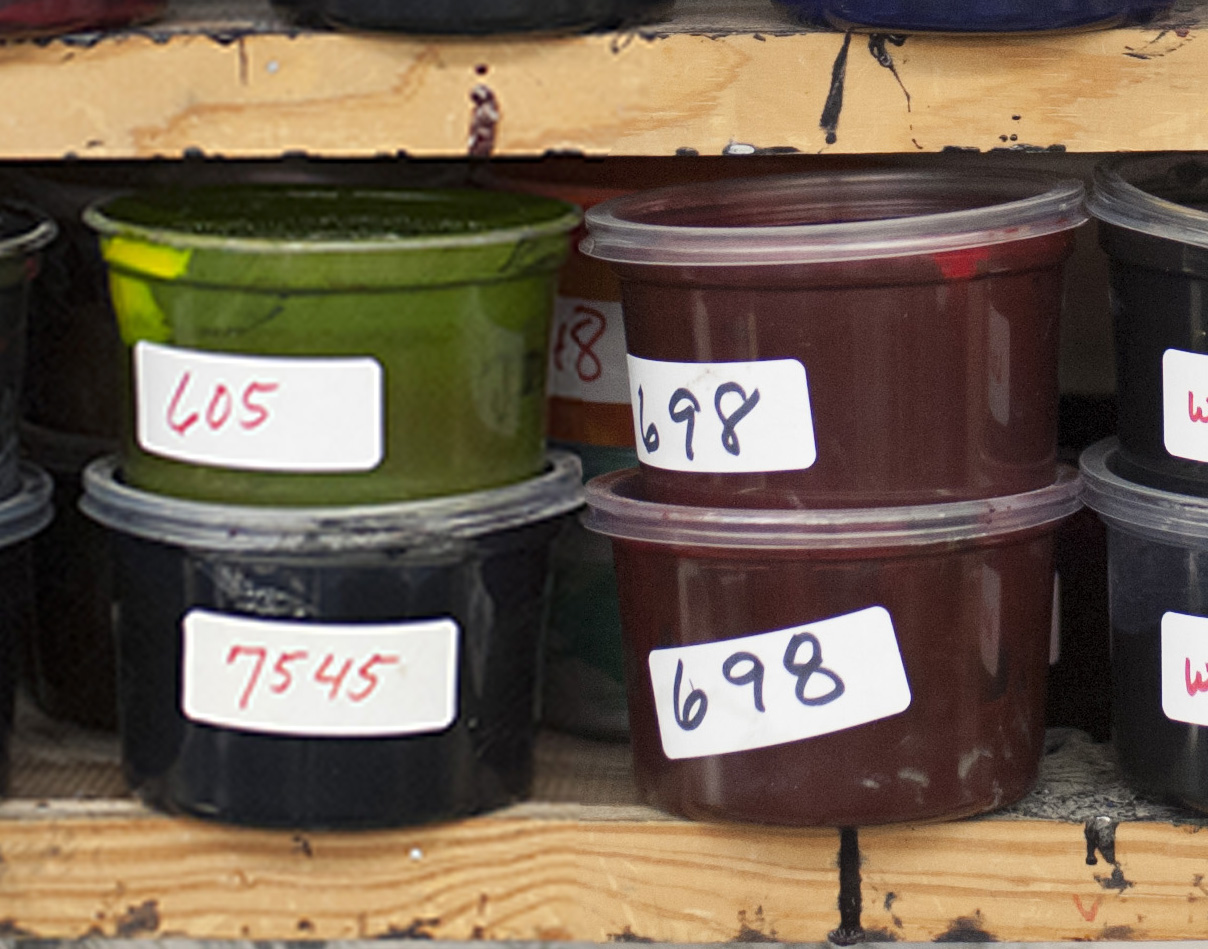 Click this image to see the difference resolution makes. The red tubs of ink (on the right) are displayed at a higher resolution than the green and blue (on the left). Notice the difference between the labels and lids; the red inks are far sharper.