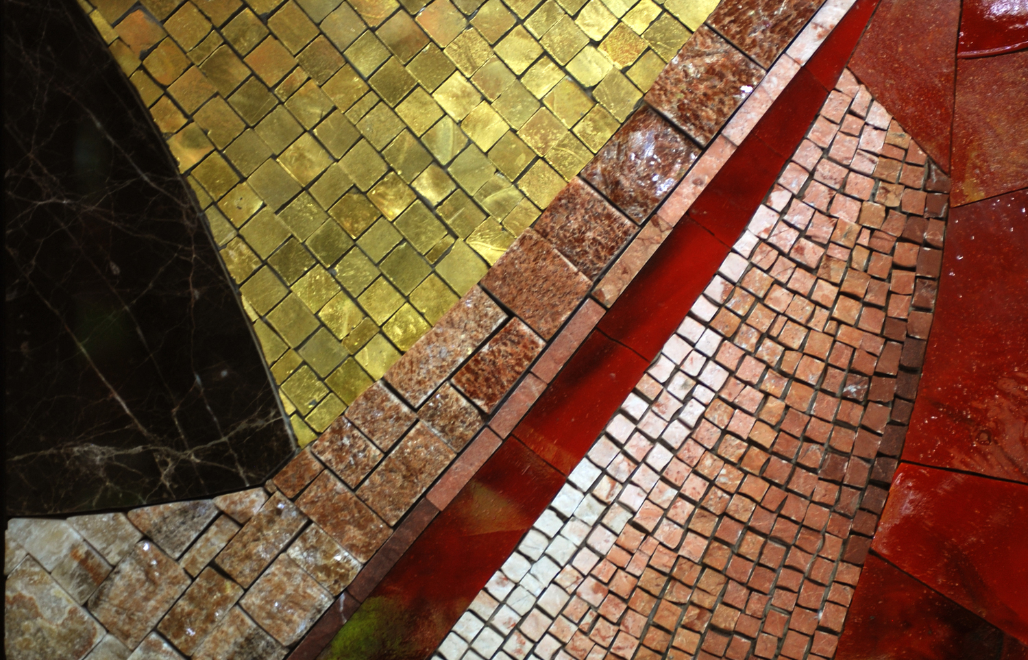 Mosaic Sample Board, showing marble slabs, cut marble, glass cakes, and gold-leaf glass smalti.