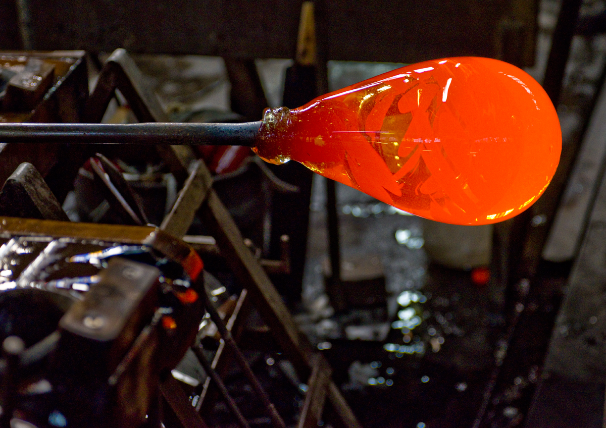 The glass on the end of the blowpipe; ready to be blown to size.