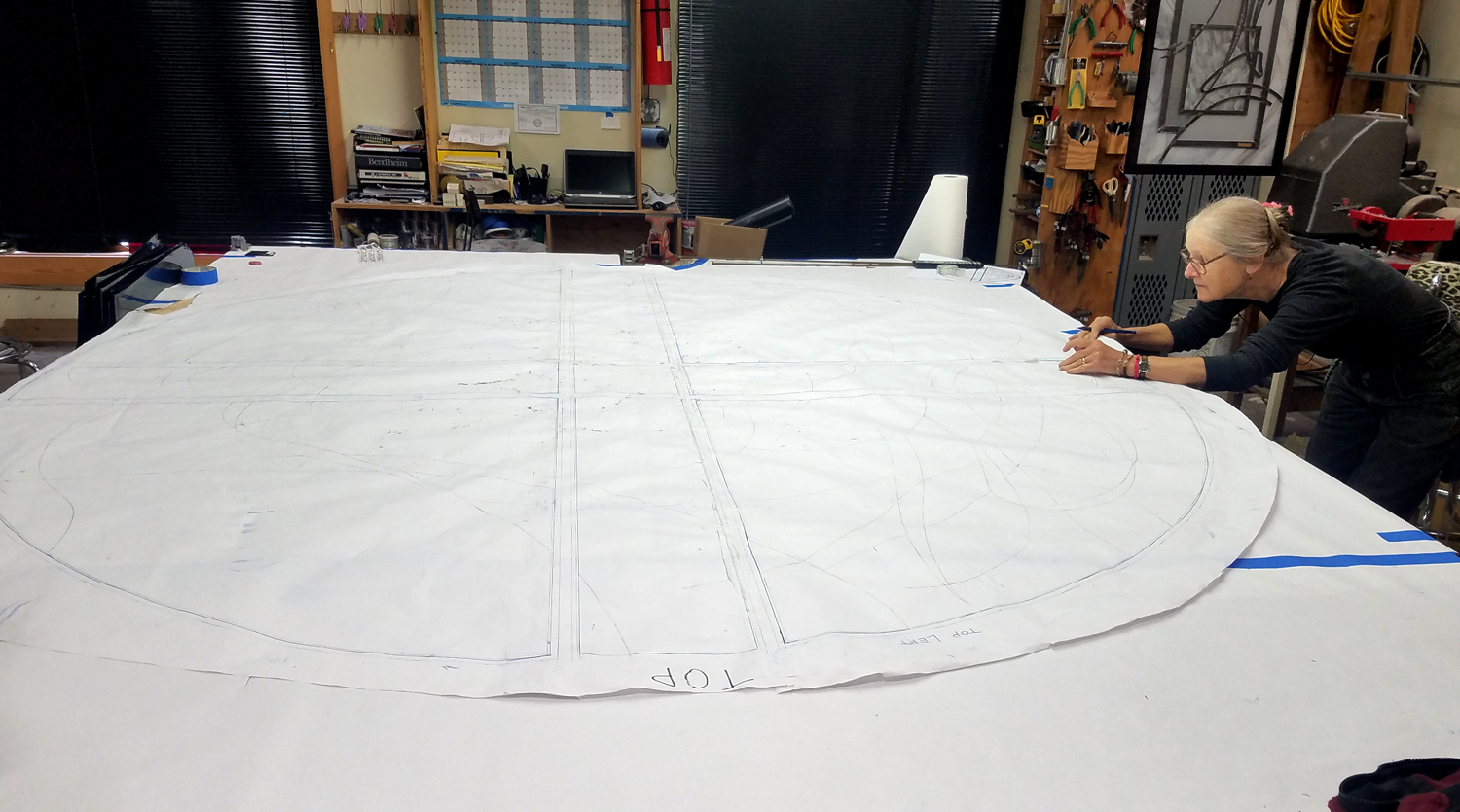 Cindy works on full-size pattern of larger window.