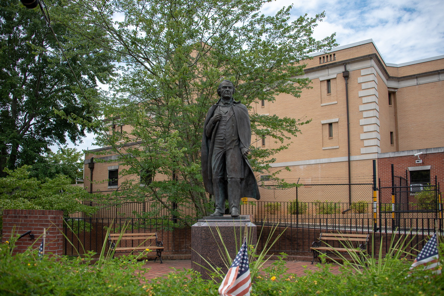 A bronze statue of President Andrew Johnson on the corner of College and Depot Street