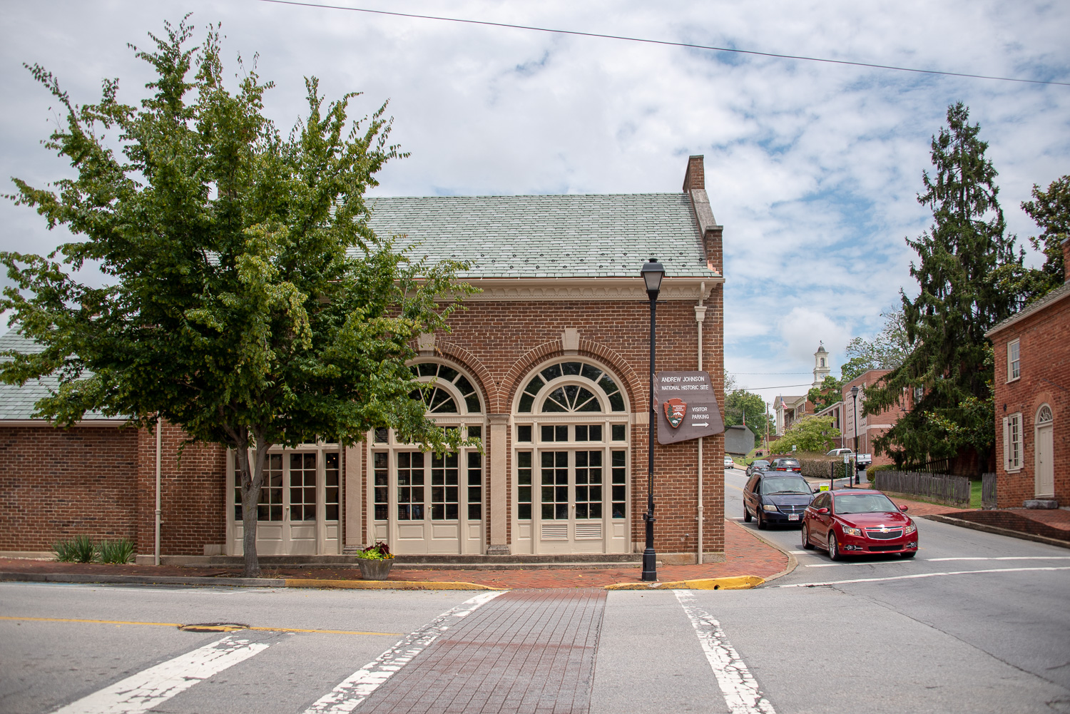 The Andrew Johnson NPS Visitor Center. Johnson's tailor shop is located just behind the large arched windows.