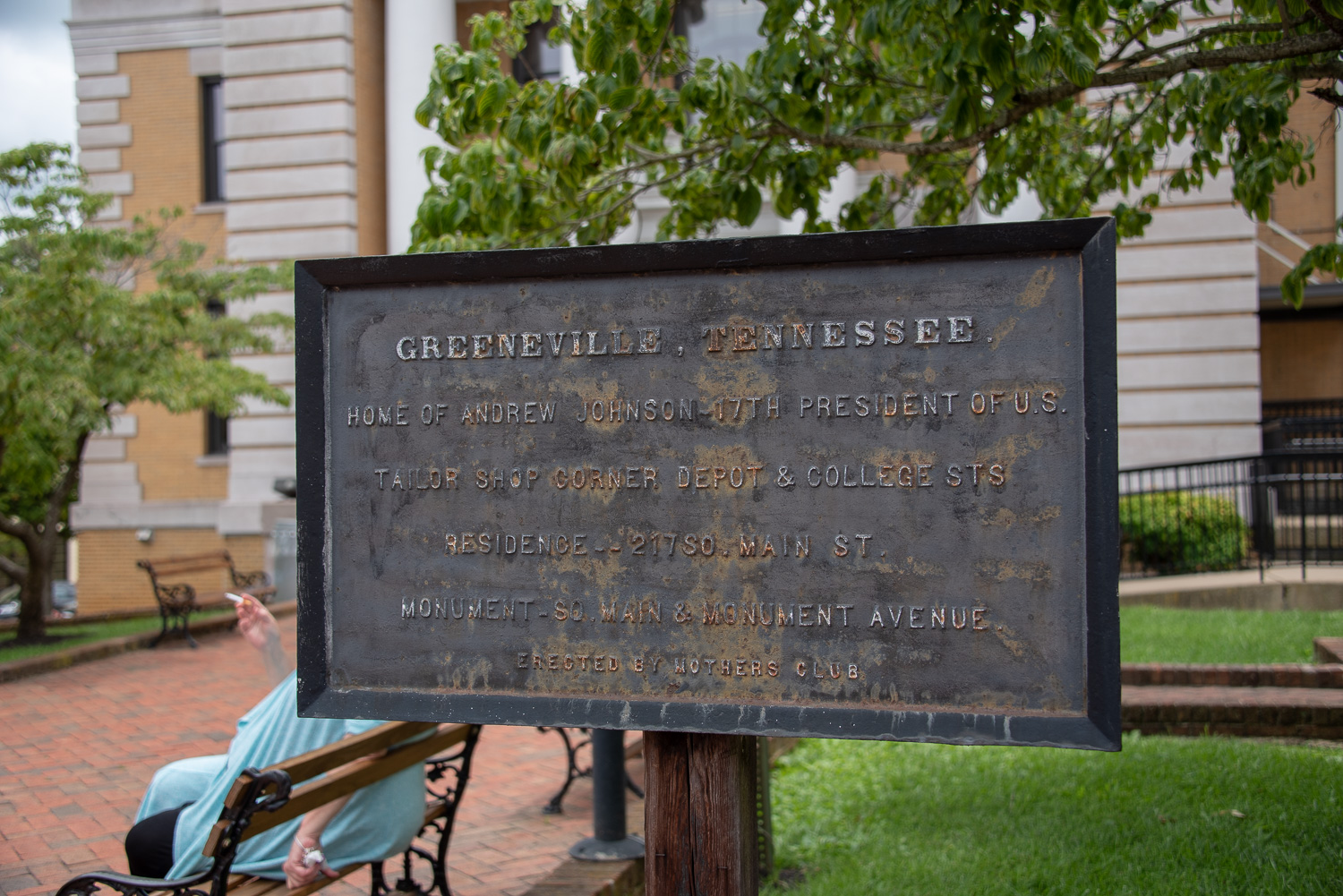 A vintage historical sign located in front of the Greene County Courthouse.