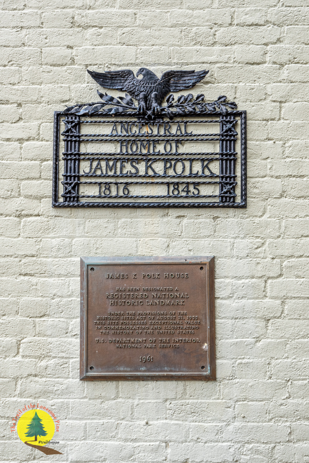 Plaques located next to the front entrance