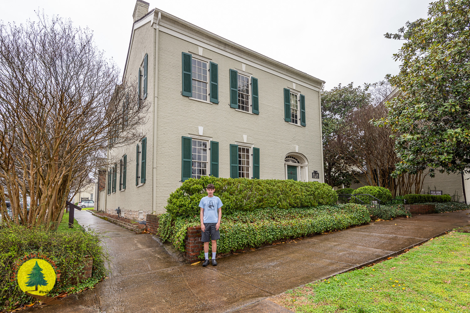 Aidan in front of the Polk Home
