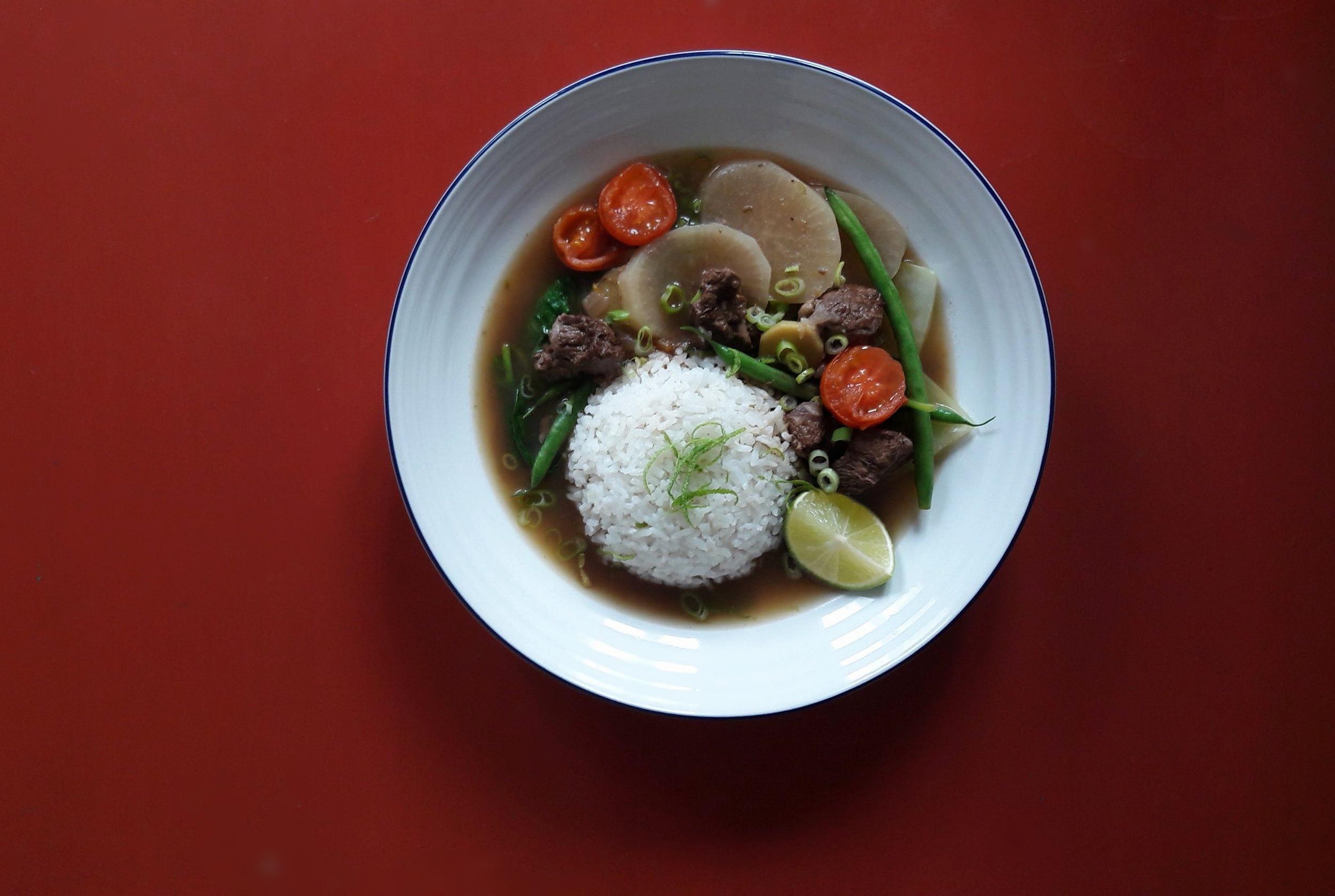 Sinigang Na Baka - A hot and sour tamarind broth with beef shortribs, daikon, ginger and pak choi