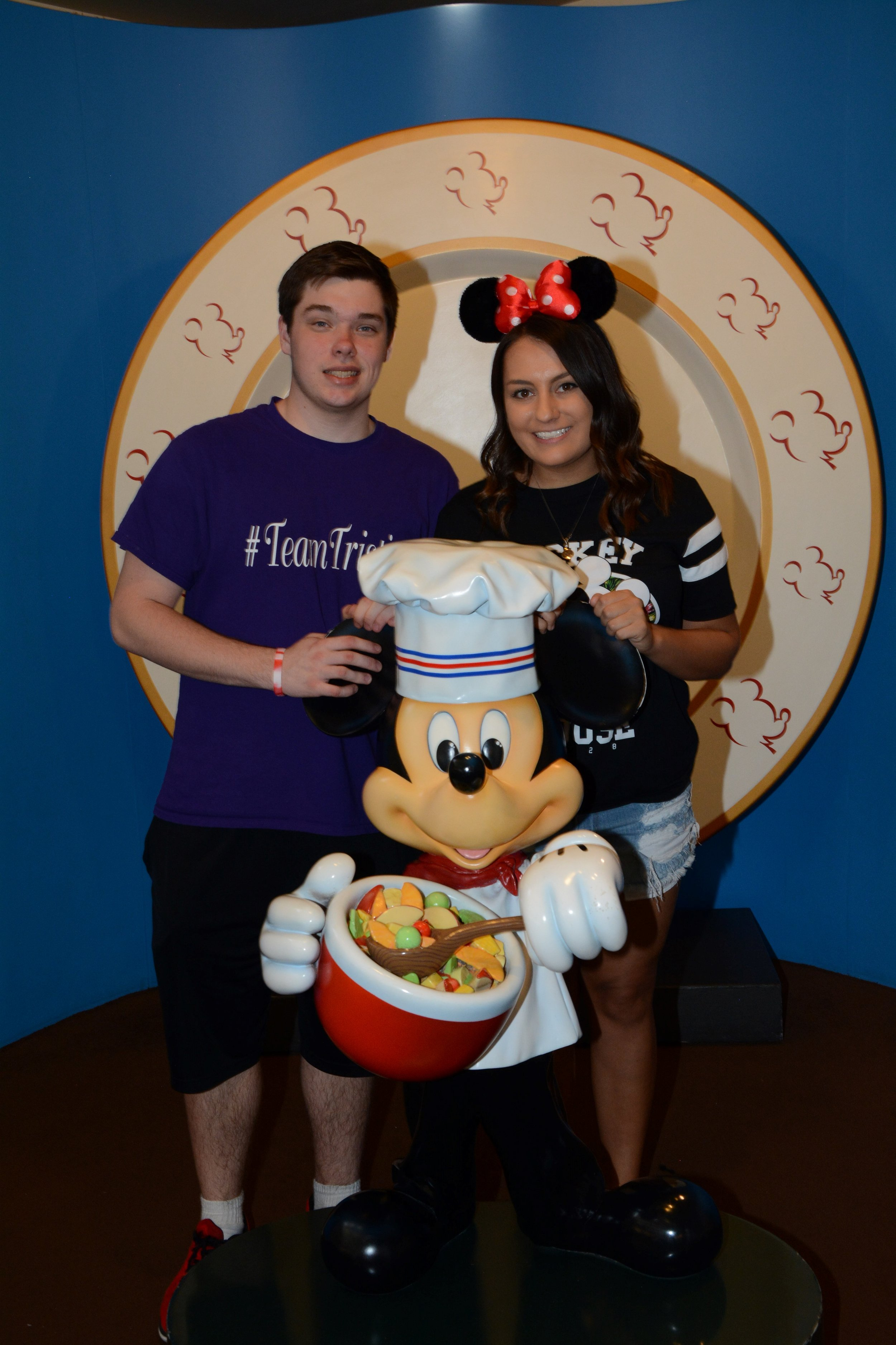 Our son, Seth, and my sister-in-law, Mallery at Chef Mickey's.