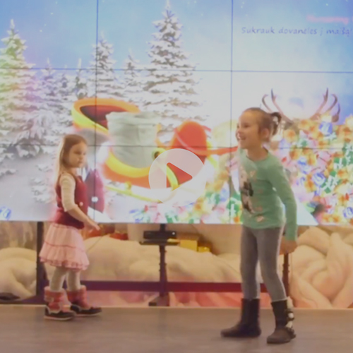 Interactive Christmas Experience at The Ozas Shopping Centre in Lithuania - The Ozas shopping center in Vilnius has a new point of attraction for the Christmas Holidays. Kids and their parents line up to play with the first and largest interactive video entertainment wall of the Baltic states. The mall's shop owners use it to natively advertise their promotions on this eye-catching Digital-out-of-Home billboard and, moreover, the results are measured and optimised by the shopping center's marketing department to improve advertising ROI for the tenants.