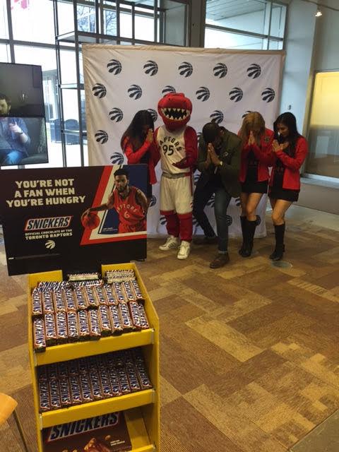 Nav with the Raptors Mascot and members of the Raptors dance pack